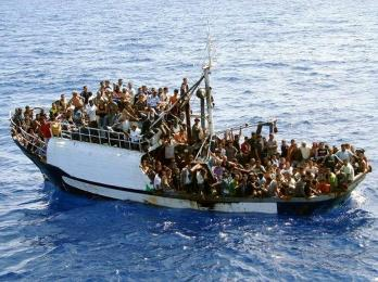 A photo released on September 25, 2008 by the Marine nationale shows a fishing boat carrying 300 illegal migrants in the Mediterranean sea, before their interception on September 24, by a French naval vessel patrolling for the EU border security agency Frontex.  The French navy released the migrants to the Italian authorities on the island of Lampedusa.  AFP PHOTO / MARINE NATIONALE