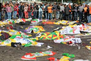 Bodies of victims are covered with flags and banners at the site of an explosion in Ankara, Turkey, Saturday, Oct. 10, 2015. Turkey's health minister says two bomb explosions in the Turkish capital have killed scores of people. The explosions occurred minutes apart near Ankara's main train station as people were gathering for a rally, organized by the country's public sector workers' trade union and other civic society groups. The rally aimed to call for an end to the renewed violence between Kurdish rebels and Turkish security forces. (ANSA/AP Photo/Burhan Ozbilici)